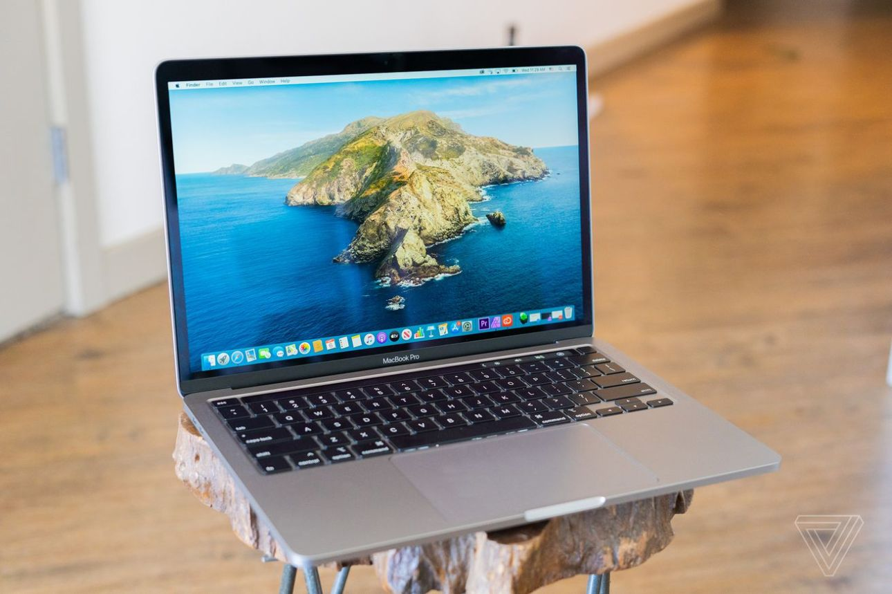A 2020 Apple MacBook Pro 13-inch with the display on and keyboard visible