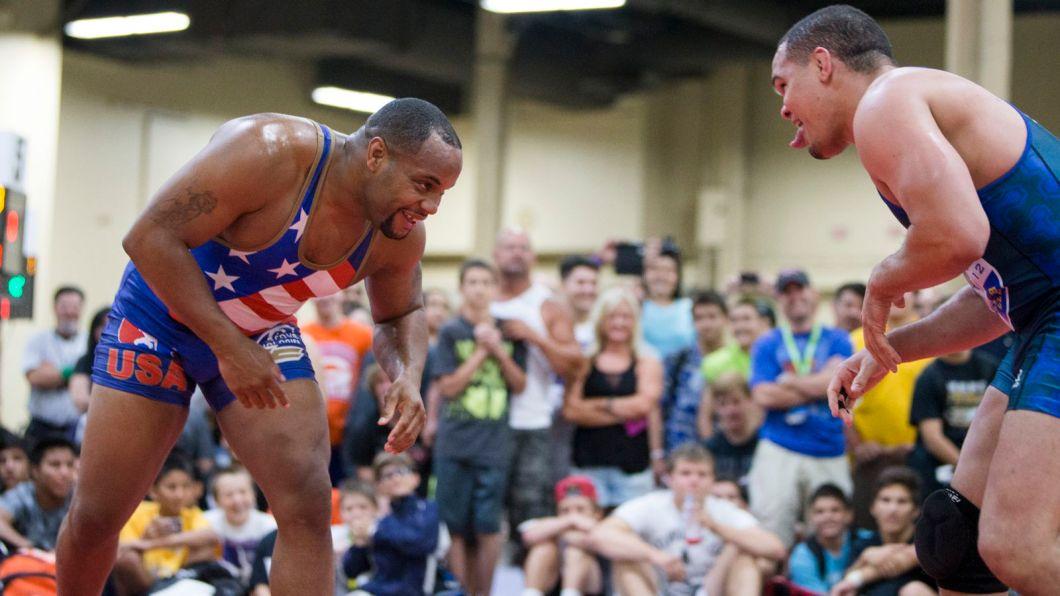 https://i0.wp.com/cdn.vox-cdn.com/thumbor/xJ5pNjeAI-1rWSaNq1BXVbJ7M4Y=/0x181:1920x1261/1600x900/cdn.vox-cdn.com/uploads/chorus_image/image/35227098/002_Daniel_Cormier_wrestling.0.jpg?w=1060&ssl=1