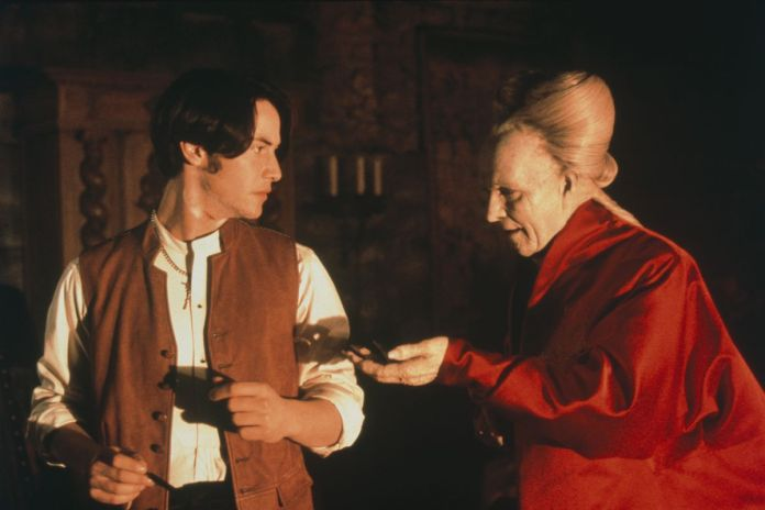 Count Dracula (Gary Oldman) reaches his hand out to Johnathan Harker (Keanu Reeves)