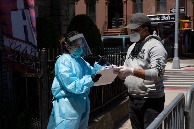 On May 13, 2020, a man signs up for a free coronavirus trial at Bethany Baptist Church in Bed-Stuy, Brooklyn.