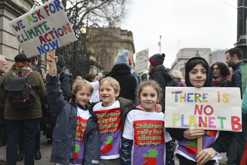 Young activists during a rally for climate, in Dublin, Ireland.