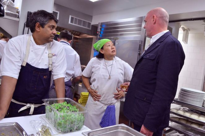 Chef Floyd Cardoz stands next to fellow chefs Anita Lo and Tom Colicchio in the Paowalla kitchen