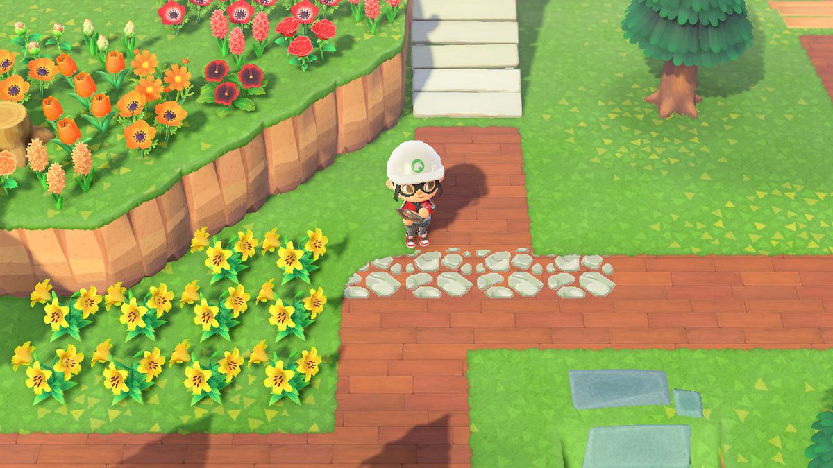 An Animal Crossing character in a hard hat after laying down a custom stone pattern on top of a hardwood path