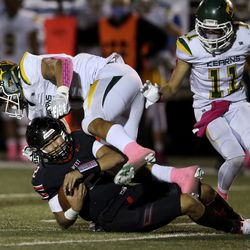 West High's QB Karson Lopati slides into Kearns' Jack Kelly (17) at West High School in Salt Lake City on Friday, Oct. 9, 2020.