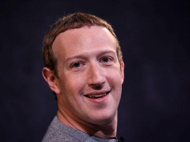 Mark Zuckerberg smiles.