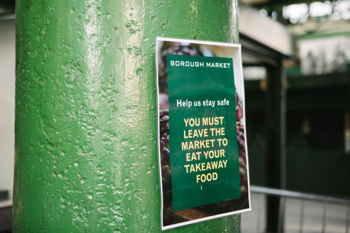A leaflet in Borough Market explaining that food purchased from one of the stalls can only be eaten outside the market