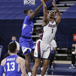 Gonzaga guard Jalen Suggs (1) shoots past BYU goalie Brandon Averette (4) during the first half of an NCAA college basketball game in Spokane, Wash. On Thursday, Jan. 7, 2021.