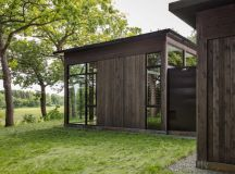 "Faceted ""shiny shed"" completes glasshouse in the woods of ..."