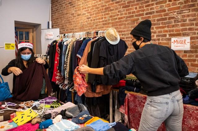 Volunteers at El Mercado de Invierno del Pueblo sort through clothes donations at the free holiday present store in Sunset Park, Brooklyn, Dec. 22, 2020.