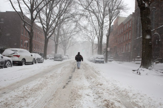 A man walks down the middle of Lafayette Avenue in Fort Greene, Brooklyn, Feb. 1, 2021.