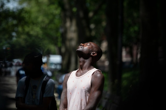 A man enjoys a maskless sunny day in Lincoln Terrace Park in Crown Heights, May 27, 2021.