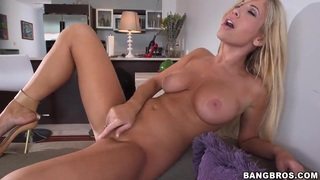 Glamour blonde chick Tasha Reign got on couch totally naked and spreading legs to masturbate her shaved twat. thumb