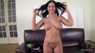 Kyra Hot shakes her over-sized titties and smiles thumb