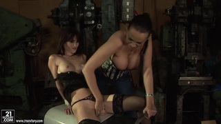 Mandy_Bright_fingering_a_hot_chick_in_a_machine_shop thumb