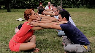 Group stretching in nature thumb
