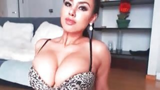 Big-tits brunette toys pussy on cam thumb