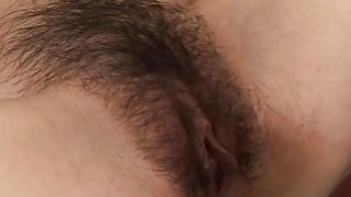 Asian lass gets her hairy pussy fingered and toyed thumb
