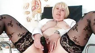 Huge boobies older madam in uniform masturbates bu thumb