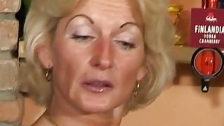Perfect granny looks for an orgasm at a bar table thumb