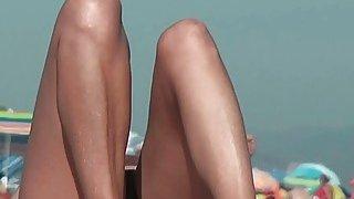 Nude spy cam_on the beach_with a black hair goddess in focus thumb