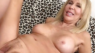 Mature blonde Erica Lauren shows off_her pussy and fucks thumb