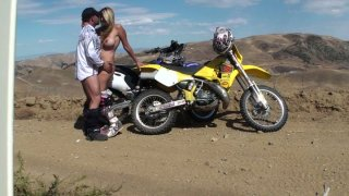 Dirtbiking gets dirty when she sucks it hard down on her knees and fucks from behind thumb
