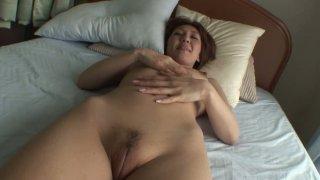 Naughty and seductive Japanese milf Mao Hosaka plays with dildo thumb