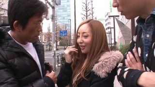 Neat and tiny Erena Aihara gets seduced on a street and agrees for a threesome sex in a porn video thumb