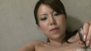 Dirty and kinky Rino Asuka plays solo with two sex toys thumb