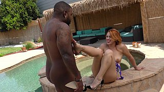 Black guy getting a BJ and footjob by the pool thumb