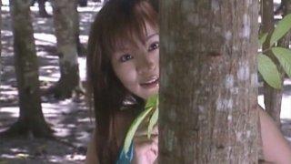 Cute and bosomy Japanese lady Yoko Matsugane walks in woods thumb