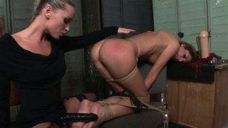 Kathia Nobili abducted Bambi and tortures her pussy with a dildo thumb