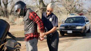 Cop Bridgette B arrested_biker Charles Dera thumb