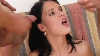 Jennifer Dark blows two cock and gets facial thumb
