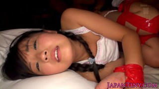 Tiny_Japanese_babes_tied_up_and_fucked_by_two_dude thumb