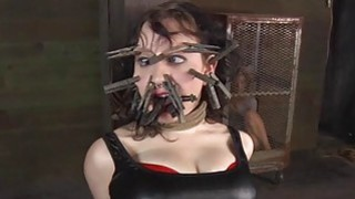 Caged hotty gets a whipping for her smooth wazoo thumb
