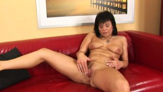 Mature brunette whore Linette rubs her time worn pussy thumb