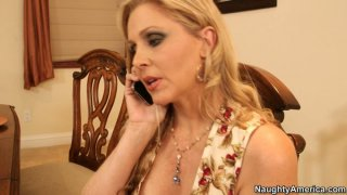 Chubby blonde cougar Julia Ann gets her pussy licked on the table thumb