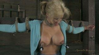 Tanned busty blondie Phoenix Marie is attached to the bar and sucks a cock thumb