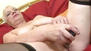 Big boobed granny playing with her pussy thumb