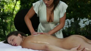 Curvy_brunette_masseuse_rubs_and_strokes_her_sexy_client's_body thumb