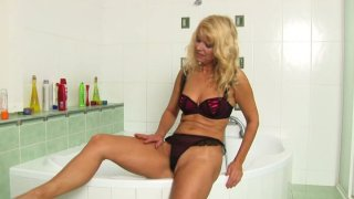 Mature blonde sexpot Marylin in her sexciting water procedures thumb