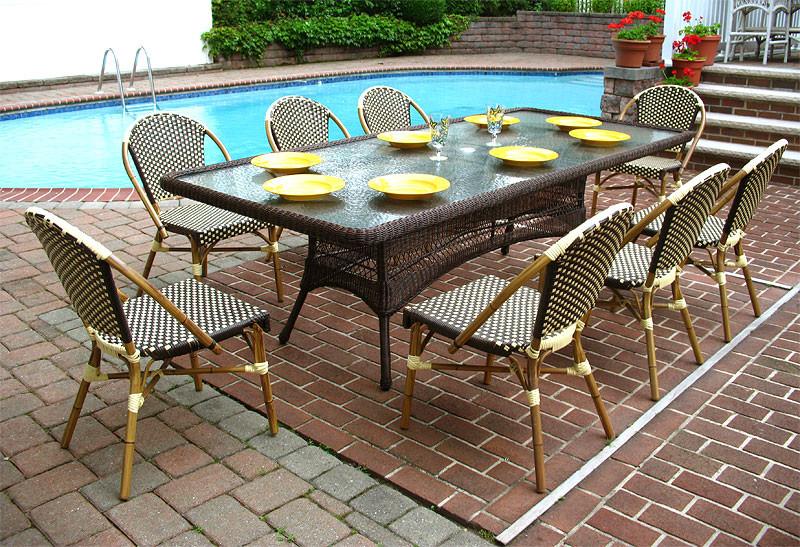 9 piece 96 x 42 rectangular resin dining set with umbrella hole