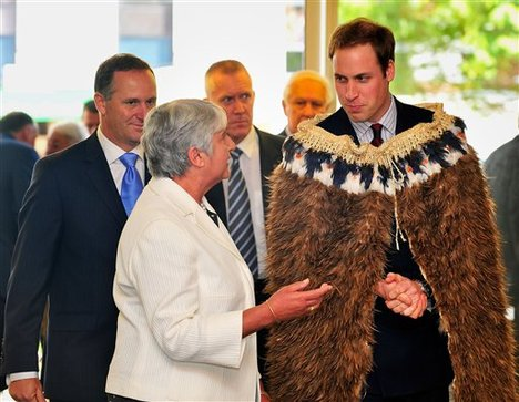 Britain's Prince William, right, listens to Chief Justice Dame Sian Elias, center left, as Prime Minister of New Zealand John Key looks on while arriving at the opening of the Supreme Court in Wellington, New Zealand, Monday, Jan. 18, 2010.
