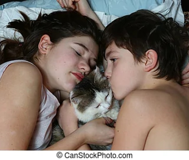 Teen Brother And Sister Boy And Girl Cuddling Cat