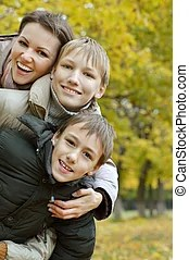 Mother and children enjoying a fun moment. | CanStock