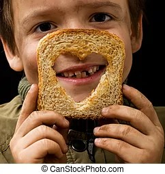 Feeding the poor - kid holding a slice of bread with dirty...