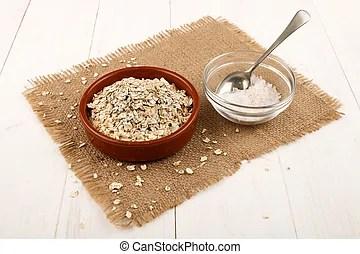 Raw organic steel cut oats in a bowl.