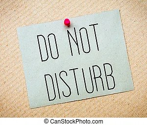 Do not disturb note. Do not disturb yellow paper office note with a red thumb tack as a warning sign to be quiet and not