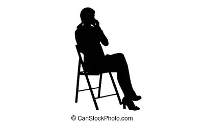 Silhouette construction worker talk with cell telephone